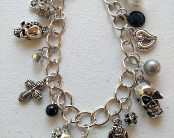 Silver plated skull and various charms charm bracelet, skull jewelry
