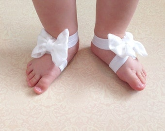 White bow barefoot sandals; baby barefoot sandals; checkered white fabric bows on white elastic barefoot sandals; baby, toddler, girl