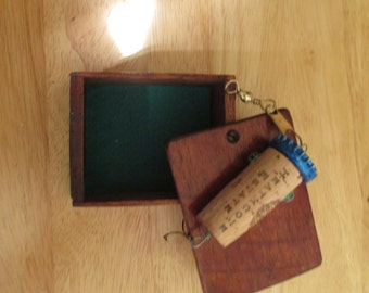 hand made fishing lure  in a vintage wooden box