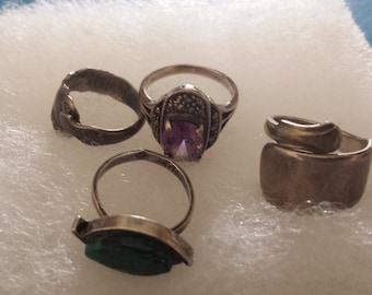 Lot of 4 silver rings: marcasite, amethyst, malachite and silver rings