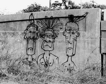 Three Little Indians is a black & white giclee fine art photography print of graffiti on a bridge. Coastal art by Steve White
