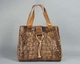 Binta's Alligator skin purse