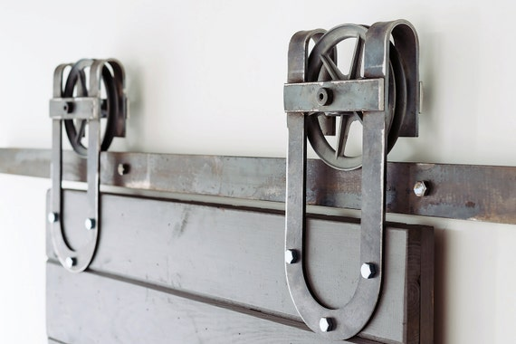 Vintage industrial spoked horseshoe styled sliding barn door