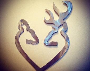 metal buck and doe deer head