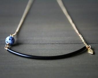Orana Necklace - asymmetric black blue modern minimal curved tube half moon leaf short
