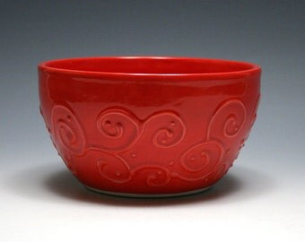 Bright Red Pottery Bowl with Swirling Vines