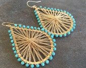Turquoise and Gold wire wrapped and woven with chain statement teardrop earrings.