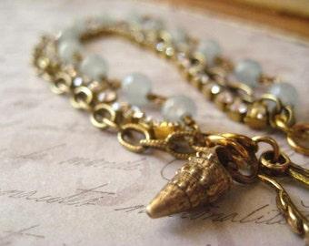 Blue Jade Bracelet, Pure Brass, Rhinestone Chain, Beach Shell Charm, Artisan Shell, Triple Chain, Pale Blue Beads, Blue Jade, Golden Brass
