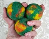 Juggling Balls in green, orange, and yellow
