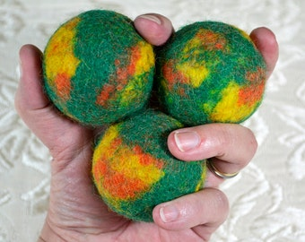 Juggling Balls in green, orange, and yellow