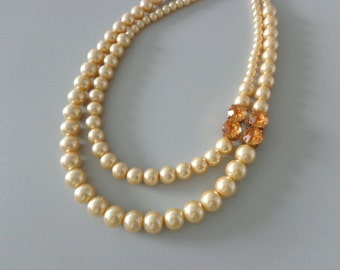 Yellow gold pearl necklace double strand rhinestones