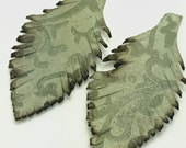 Two Green Swirl Leather Feathers 030
