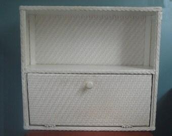 Two tier wicker shelf with door