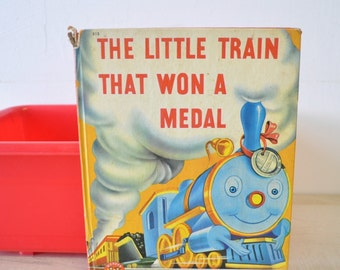 1940s vintage childrens book / The Little Train that Won a Medal / wonder books