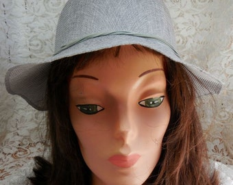 Cloche Hat in Stiffened Gray Linen - with dainty band all around and Pretty Floral arrangement in back.