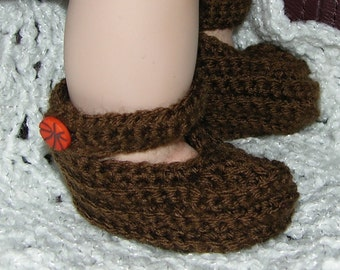 Brown booties with strap and button.