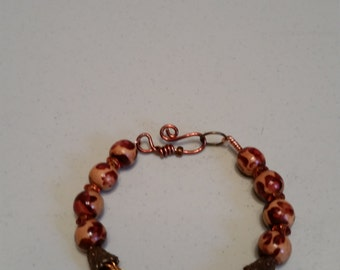 Viking knit bracelet with copper and wood beads