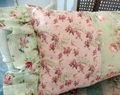 Pretty greens and roses in pink small birds and bunches of more roses pillow