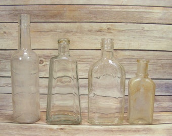 Glass Bottles Collection of 4 vintage glass bottles