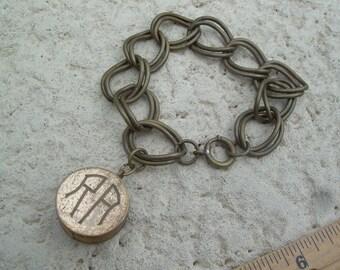 Antique Ernest Steiner Brass Token or Coin Holder, etches Monogram RA Bracelet Unique find