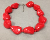 oversize chunky red nugget choker necklace, red plastic, thermoset, lucite, wilma flintstone, betty rubble, cave woman, halloween, eighties