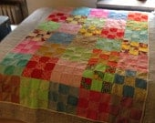Amazing quilt made of retro polyester squares