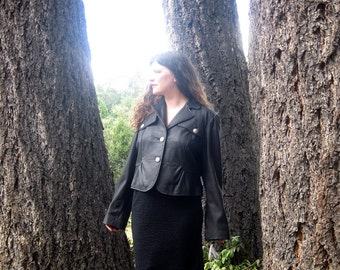 1980s black leather jacket Wilsons new from the 80s XL
