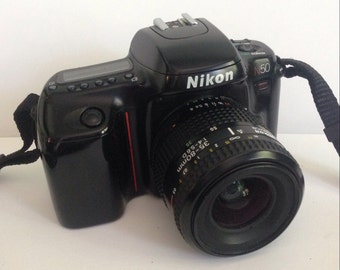 Nikon N50 SLR (Single Lens Reflex) Non-Digital Camera, with Zoom, Nikon Strap, Instruction Booklets -- Mint Condition Vintage Camera