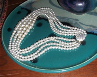 """Vintage Japan Pearl Necklace, 4 Strands white color, 18"""" long with a beautiful multi crystals/ diamond stamped pendent!-Price reduced!"""