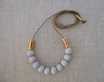 Gold Tube Porcelain Necklace
