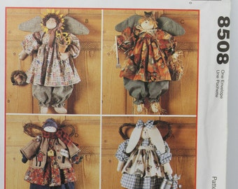 "McCalls 8508 Craft Faye Wine Seasonal Angels 22"" Bunny 20"" Sunflower 21"" Scarecrow 21"" Snowman Stuffed Animal Rag Doll Uncut Sewing Pattern"