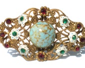 Vintage Rhinestone Jewelry Brooch Ornate Stamped Filigree with White Flowers Green & Red Stones with Art Glass Signed West Germany