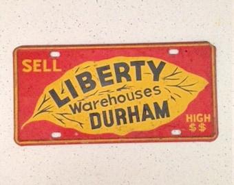 Vintage Liberty Warehouses Durham, North Carolina, car license plate tag, 1940s tobacciana advertising tin