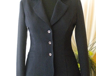 Women's classic dark blue jacket, three metal buttons and lining.