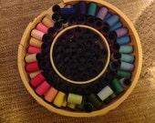 Assorted small thread spools