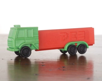 Vintage Truck Pez dispenser, C Series green R-4 cab, 3.9 red stem, Yugoslavia, rolling wheels, candy collectible plastic toy, semi trailer