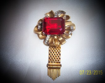 Vintage Rare Kreisler Brooch With Large Emerald Cut Red Crystal in a Gold Tone Setting