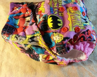 SassyCloth one size pocket diaper with Supergirl wonder woman cotton print. Made to order.
