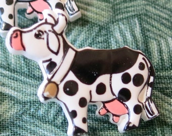 """3 Realistic buttons, black and white Friesian cows with bells! 1""""inch long.  Self shank, plastic, fun buttons, very cute!  HMFR13.6-19.82."""