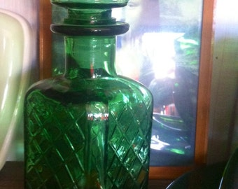Green glass 1970s decanter , made in Italy .