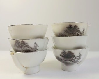 Six Japanese whistling cups, guinomi, sake cups, white porcelain with black decoration