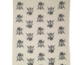 Black Christmas Beetle linen tea towel (Natural and off-white)