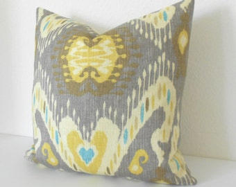 Yellow, tan and turquoise ikat decorative pillow cover