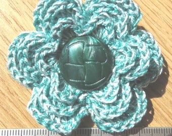 Irish crochet flower brooch in green cotton with green button centre