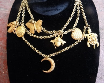 Vintage charm necklace gold tone