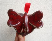 Red butterfly on a red heart . Wedding decoration, symbol of love.