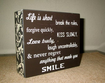 Life is Short Break the Rules Forgive Quickly Kiss Slowly Love Truly Laugh Uncontrollably & Never regret anything that made you smile Sign