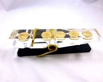 Lucite Paper Clip With U.S. Pennies