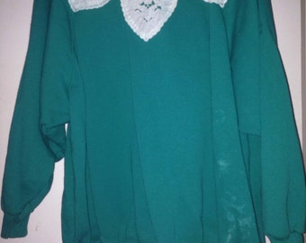 Teal crewneck with embellished neckline