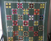 Colorful antique bear paw quilt, ca.1890, lovely quilting and many late 19th century printed fabrics